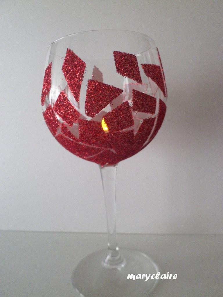 bicchiere rosso con candelina