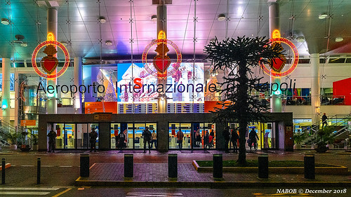 Naples, Italy: Low-keyed Christmas decorations in Capodichino International Airport at 4:00 am with armed guards