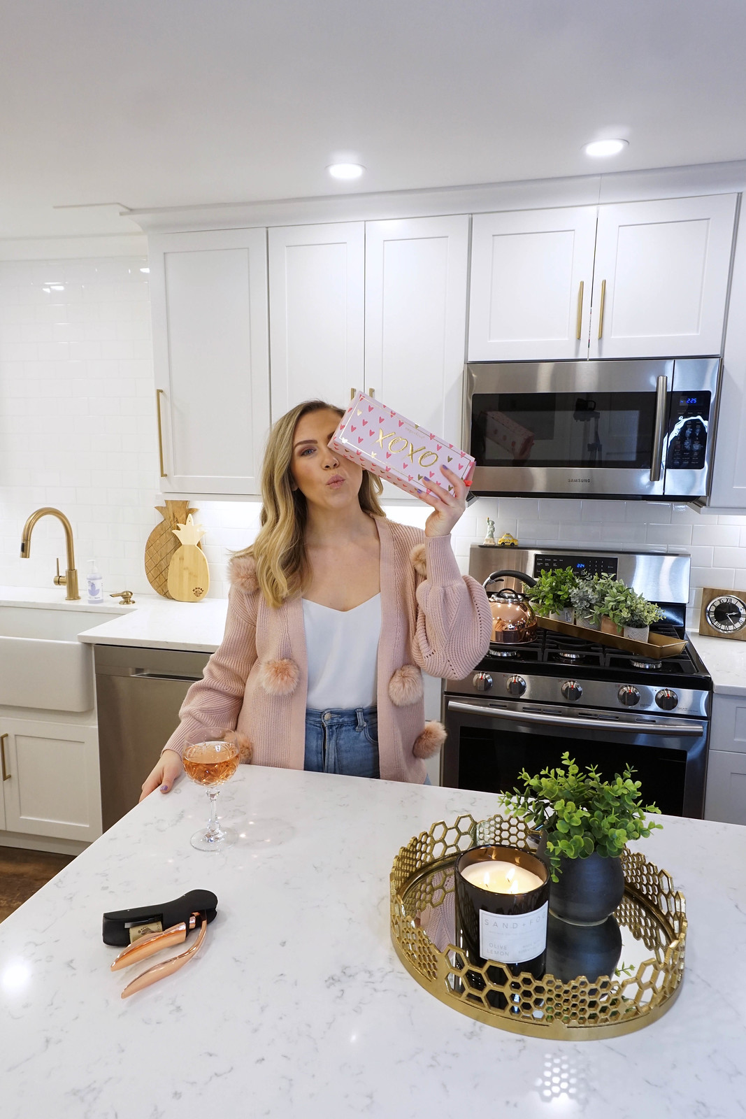 Pink Pom Pom Cardigan XOXO Sugarfina Valentine's Day Candies White Kitchen Gold Hardware Stainless Steel Appliances