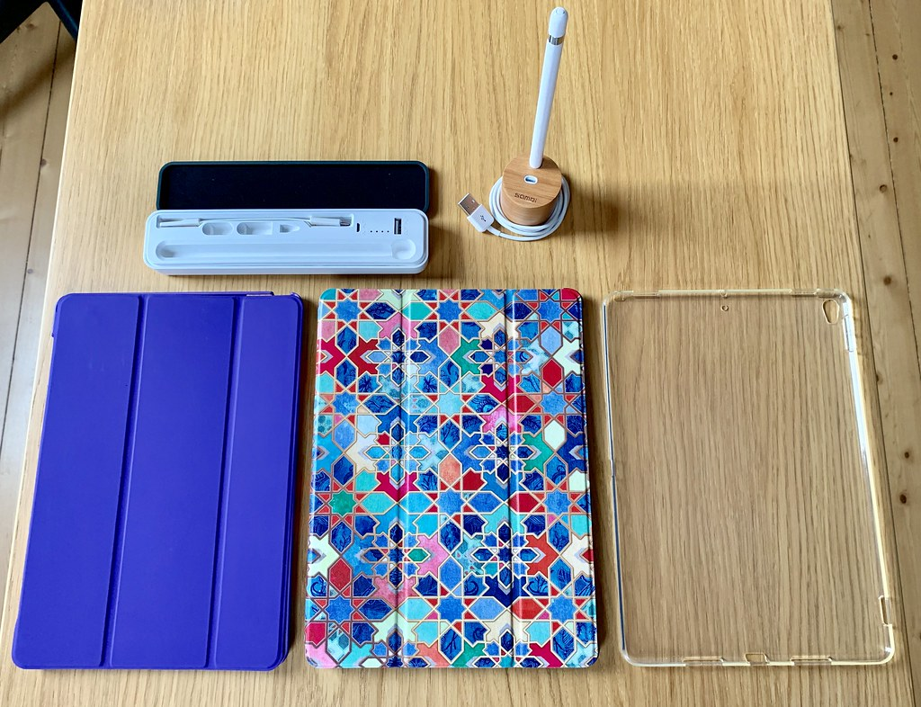 "iPad Pro 10.5"" TPU cover, two third-party smart covers, Apple Pencil pot and charging case"