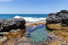Crystal clear water Queen's Bath pool Princeville Kauai Hawaii