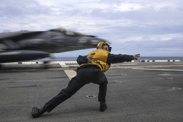 PACIFIC OCEAN (Jan. 15, 2019) Aviation Boatswain's Mate (Handling) 2nd Class Brittany McGhee, assigned to amphibious assault ship USS Boxer (LHD 4), signals an AV-8B Harrier attached to Marine Attack Squadron (VMA) 214 to take off during flight deck operations.  Boxer is underway conducting routine operations as a part of USS Boxer Amphibious Ready Group (ARG) in the U.S. 3rd Fleet area of operations. (U.S. Navy photo by Mass Communication Specialist 3rd Class Justin Whitley)