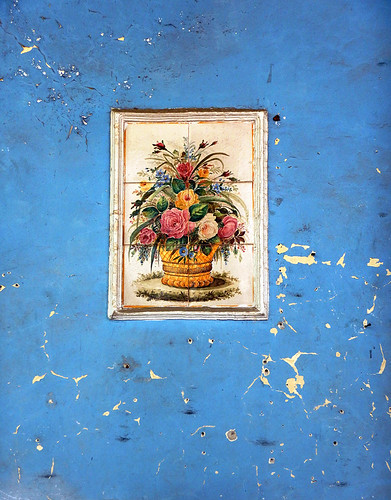 San Angel, Mexico: textures of paint, plaster and tile on a blue wall