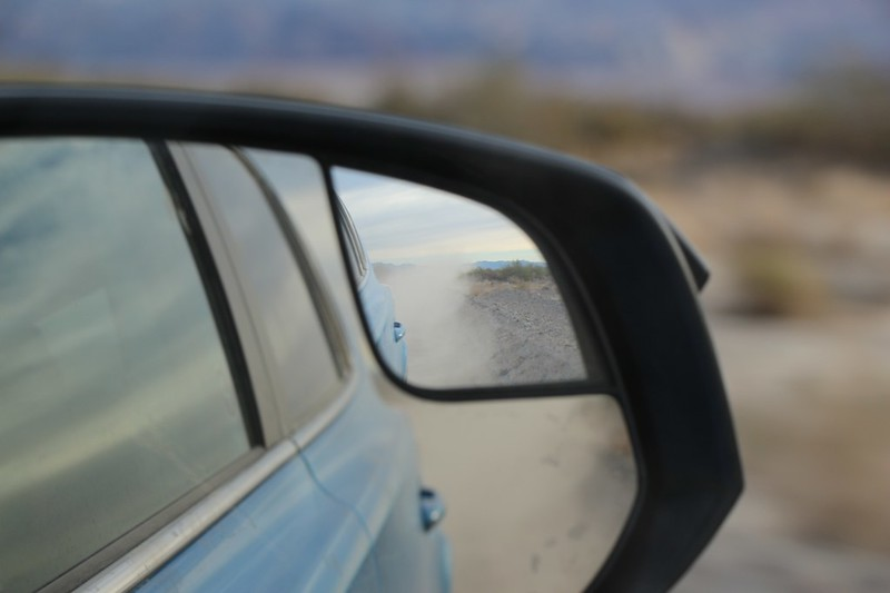 Dust clouds in our rear-view mirror as we blast along the easy-driving West Side Road in Death Valley