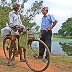 IWMI researcher (right) speaking with a farmer at Thirappane in Anuradhapura District, North Central Province of Sri Lanka