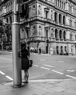 Lady waiting at crossing in Sydney, Australia