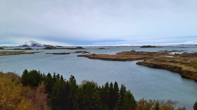 View of small islands across Lake Myvatn with a stormy sky.