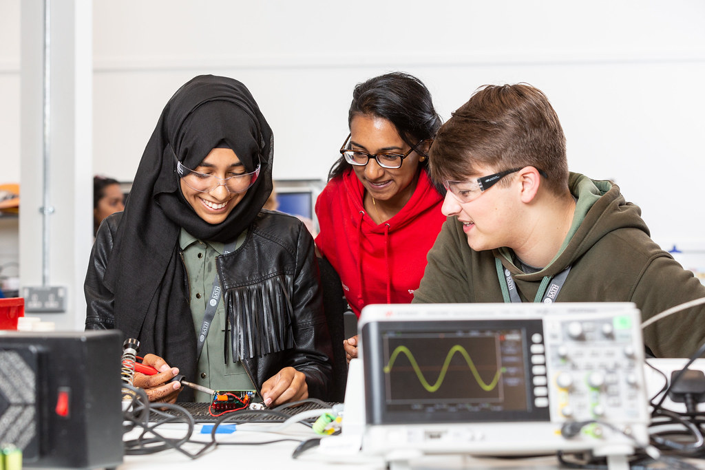 students in a laboratory working on an Electrical Engineering project.