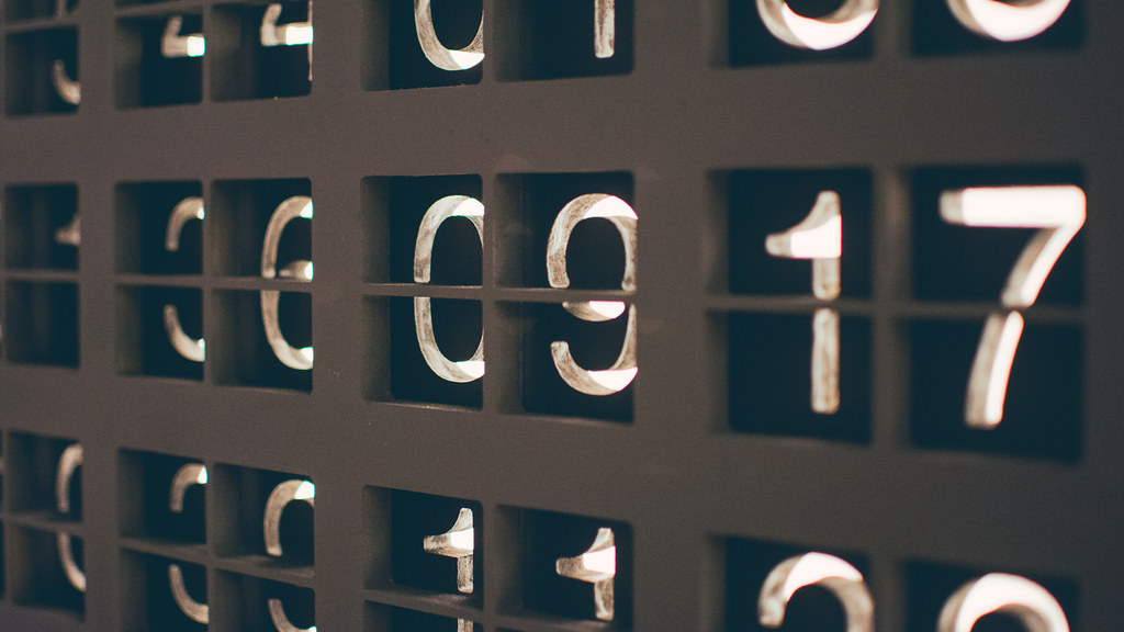 A series of number appearing on a large display