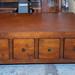 Dark wood coffee table E125