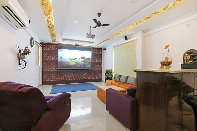 A modern home theater system in an apartment with projector