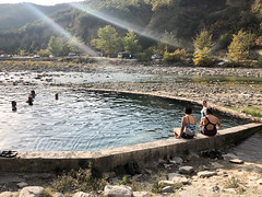 The best move after a day of cycling in intense Albanian heat? Soak in a thermal pool of course.