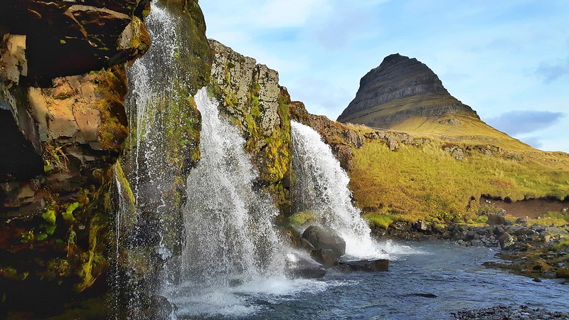 Triple waterfall with conical-shaped mountain behind. Kirkjufellsfoss Waterfall, Snaefellsness Peninsula, Iceland