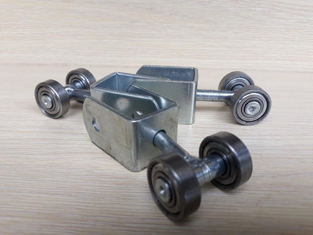 Bánh xe mang treo cửa lùa U Xoay GHP-1428 bán sỉ giá rẻ