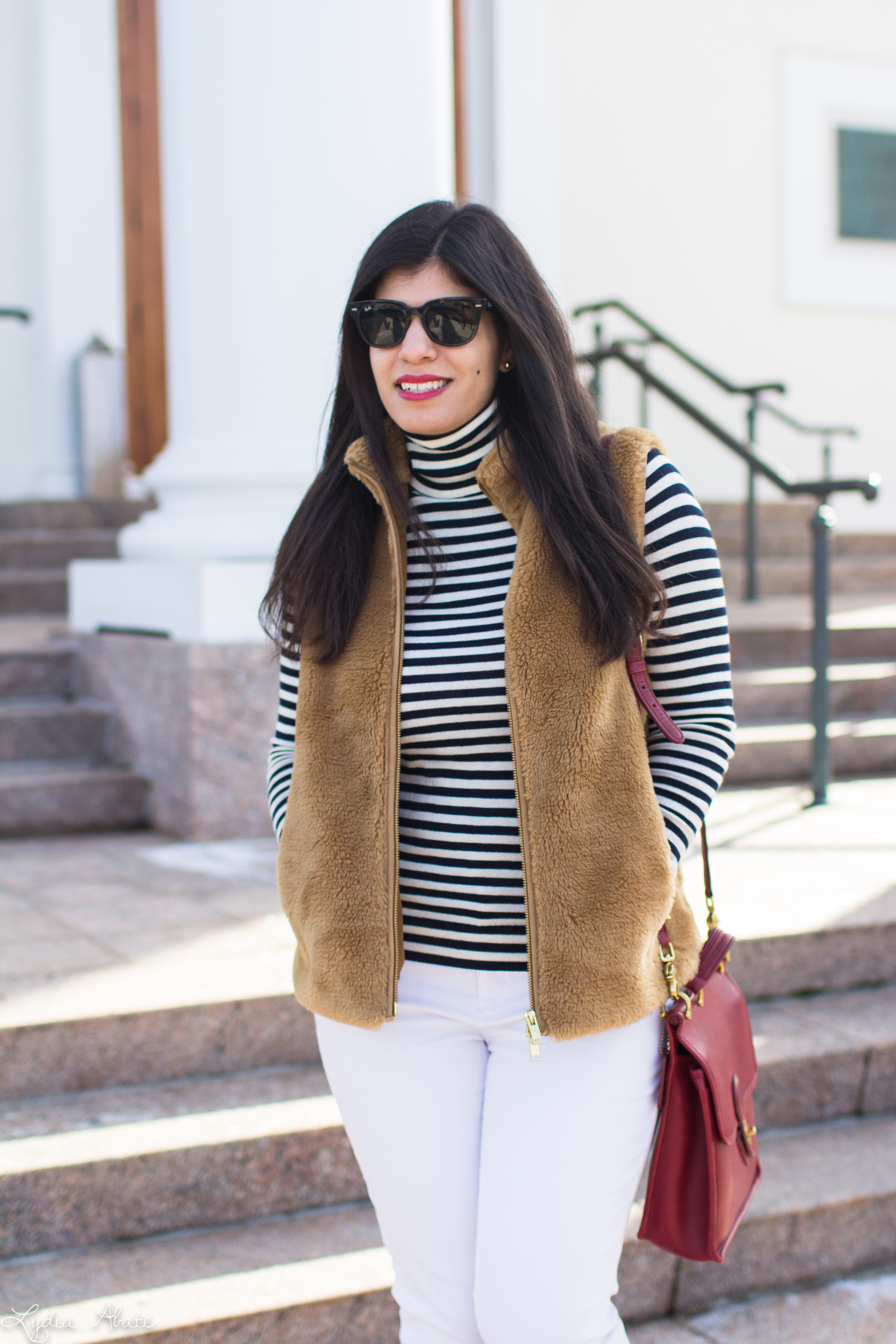 J.Crew plush excursion vest, striped shirt, white jeans, red Ferragamo bow pumps, coach bag-6.jpg