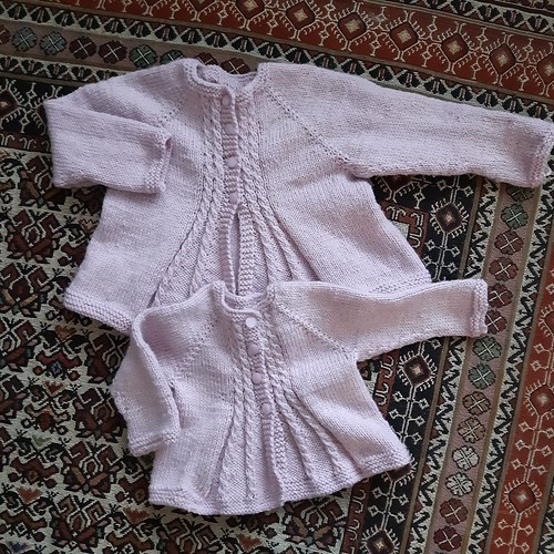Carola has both of her sweet Bobby's Girl Cardigan's by Alma off her needles!