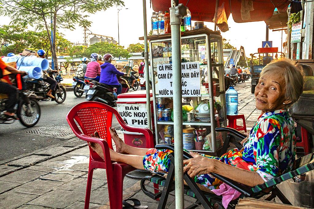 Old woman at sidewalk cafe on Cao Van Kiet--Saigon