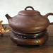 Yixing hehuanhu shape teapot with flower decoration