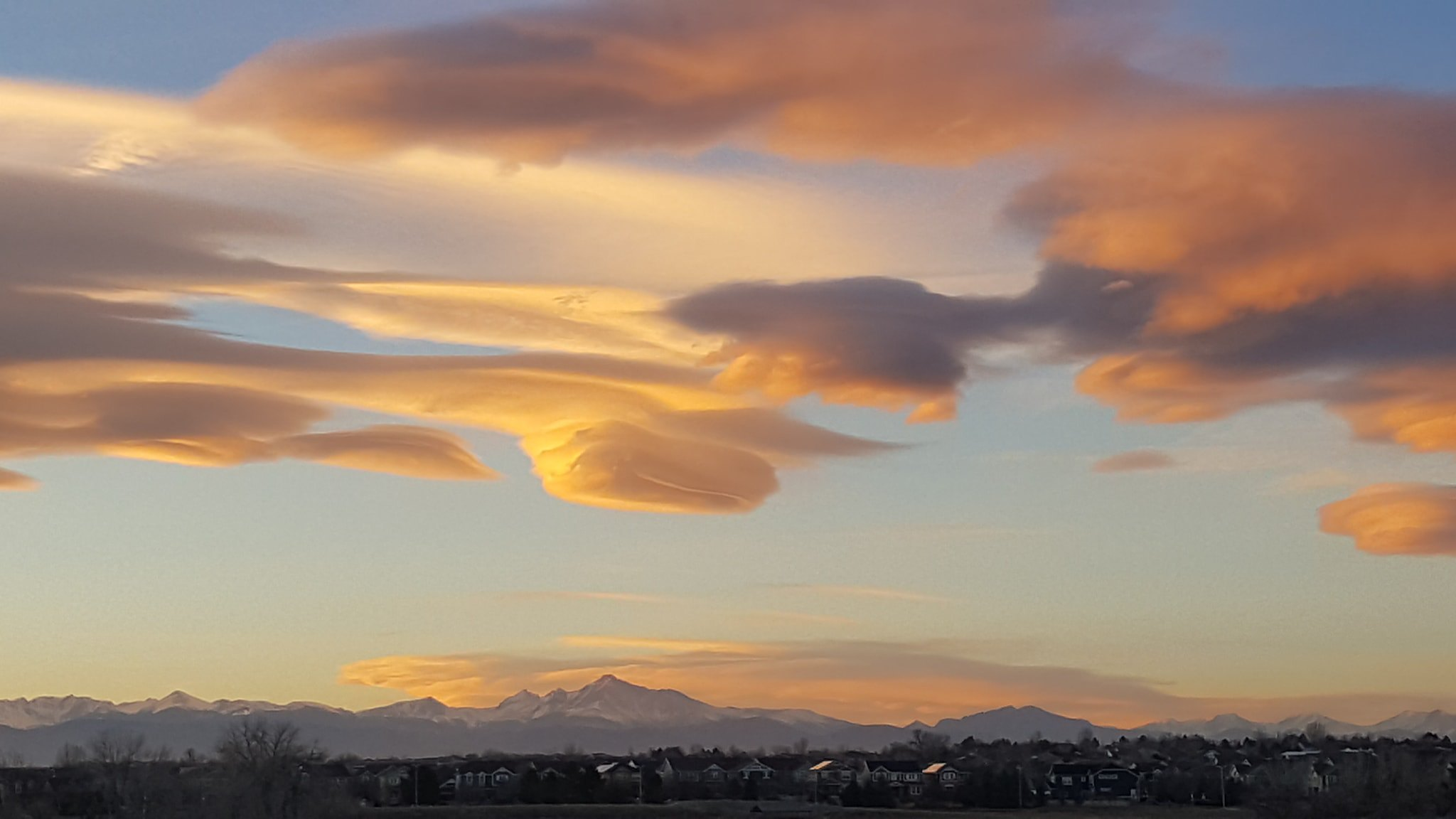 Stunning lenticular clouds at sunset over the Colorado Front Range. (David Canfield)