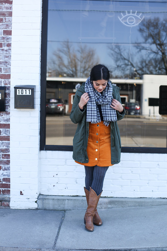 green Old Navy Parka, Priya the Blog, Nashville style blog, Nashville style blogger, Nashville fashion blog, Nashville fashion blogger, cowboy boots, how to wear cowboy boots, Nashville cowboy boots outfit, 70s inspired outfit, 70s wear to work outfit, winter fashion, winter outfit with cowboy boots, winter wear to work outfit, corduroy skirt, winter outfit with layering, how to style a corduroy skirt, checked scarf