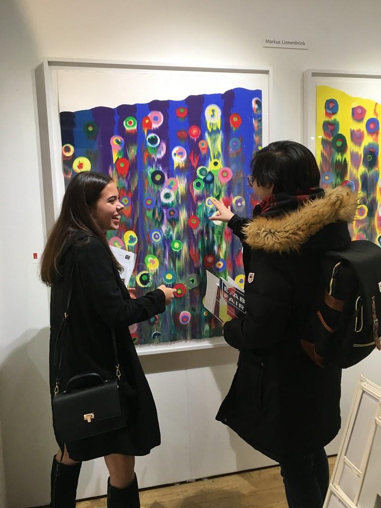 Art students Sabrina Haertig (B.F.A. '22) and Sh'yee Meng (B.F.A. '21) at the 2018 Fine Art Print Fair in New York City.   photo / Julianne Hunter, AAP Printmaking Specialist