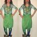 20180501 1756 - fashion show - Clio - green shirt, skirt, peacock leggings - diptych.17.56.47.57.21