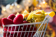 Healthy - A shopping cart stuffed with raspberry and physalis