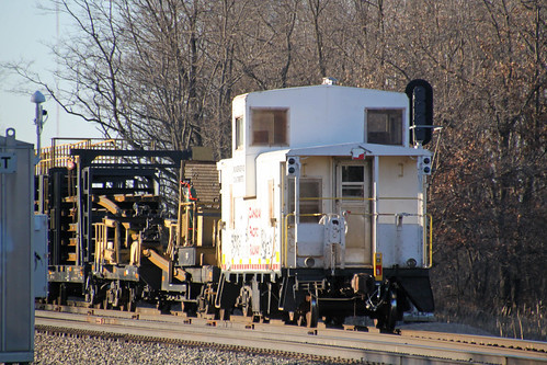CP 420982 follows the rail train along the siding