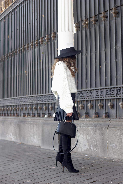 black pleated skirt  white sweater louis vuitton bag street style inspiration 20196