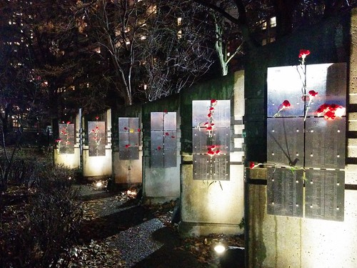 AIDS Memorial in red and white at night (6) #toronto #aidsmemorial #barbarahallpark #hiv #churchandwellesley #churchstreet #flowers #carnations #red #white