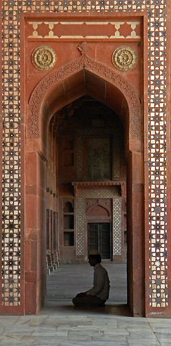 A man praying in a doorway at Fatehpur Sikri, a mosque just outside of Agra, India