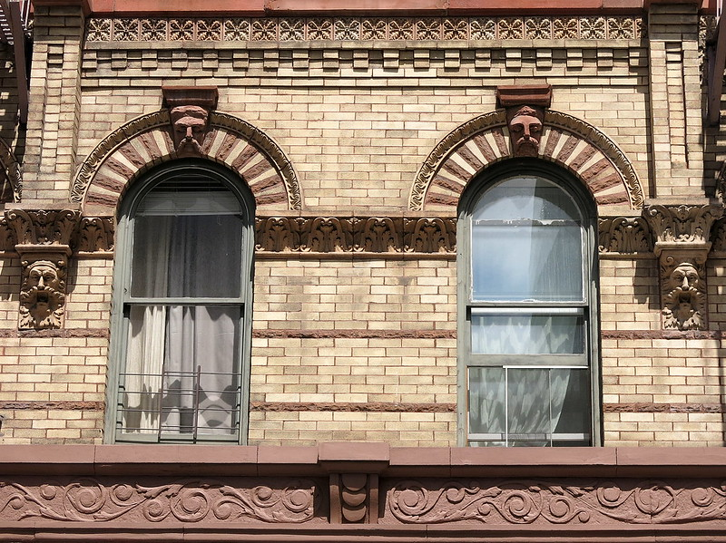 Faces at the windows: West 10th Street, Greenwich Village, New York