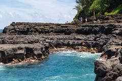 Cliff jumping Queen's Bath Princeville Kauai, Hawaii