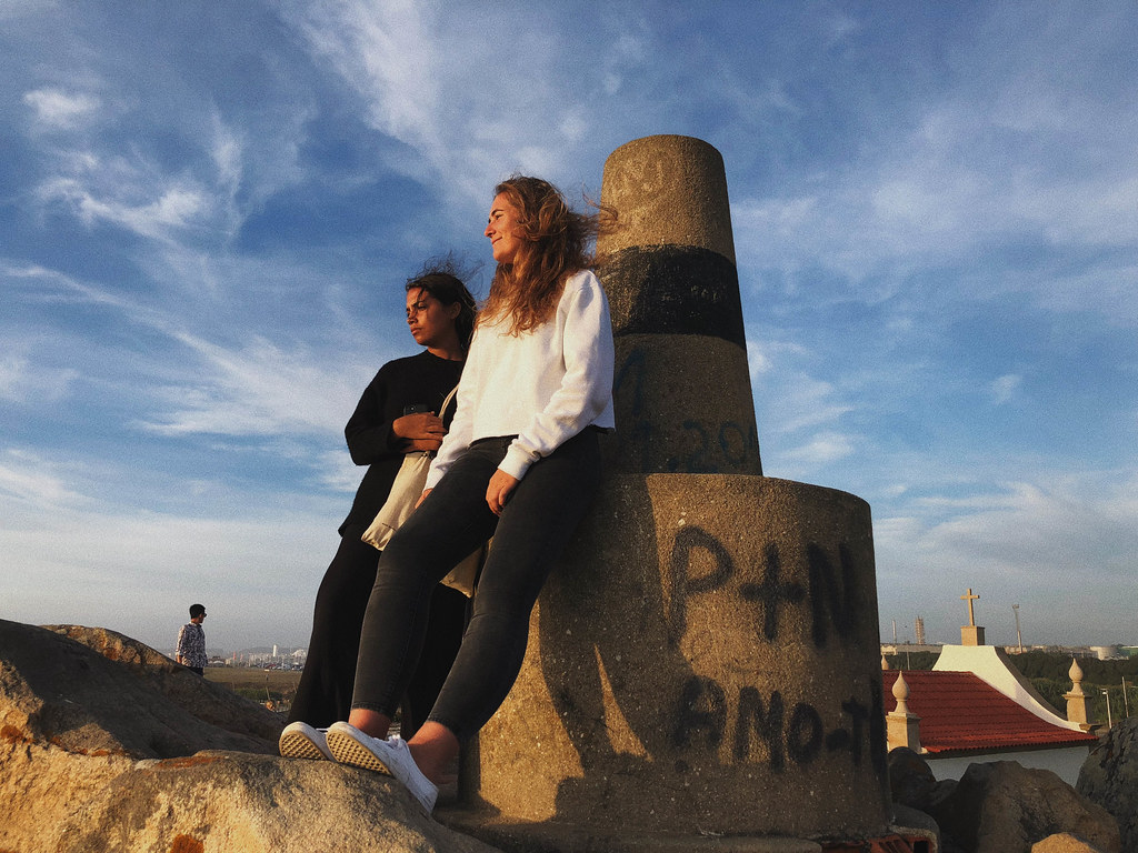 While in Portugal, Morgan Judge-Tyson (B.Arch. '20) and Ottavia Boletto (B.Arch. '20) enjoy the view after climbing a hill next to the Boa Nova Tea House (seen in the background) designed by Álvaro Siza Vieira.   photo / Ihwa Choi (B.Arch. '20)