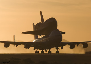 NASA's modified Boeing 747 Shuttle Carrier Aircraft with the Space Shuttle Atlantis on top lifts off from Edwards Air Force Base to begin its ferry flight back to the Kennedy Space Center in Florida. Original from NASA. Digitally enhanced by rawpixel.