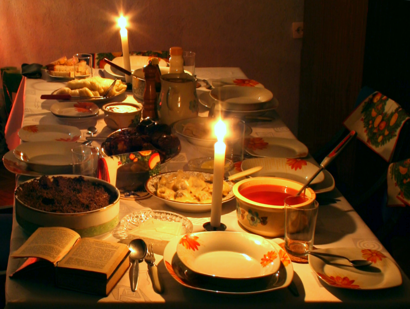 Traditional setting of the Christmas Eve table in Poland. Wigilia is the traditional Christmas Eve vigil supper, following a day of abstinence and traditionally begininng once the First Star has been sighted. The meal excludes meat, as abstinence is required and should comprise twelve distinct dishes in memory of the twelve Apostles. It begins with a soup, either Borscht with Uszka (tortellini), or wild mushroom consommé, followed by herring in different forms. Fish provides the main dish of the Christmas Eve feast across Poland. There are variations of carp fillet, carp in aspic, gefilte fish (Jewish-style carp), sweet with onions, carrots, almonds and raisins. Accompaniments consist of cabbage, cooked red or Sauerkraut with apple salad. The bread served at the meal is often Challah, doubtless borrowed from Poland's centuries long Jewish fellow countrymen. Then there is an array of desserts, including, dried fruit compote, followed by cake: poppy seed cakes, Babka (cake), (makowiec), and other delicacies including edible Christmas ornaments. Regional variants include, żurek (sour rye soup), siemieniotka (in Silesia), Kulebiak, pierogi filled with cheese and potatoes as well mushrooms and cabbage, stuffed cabbage with mushrooms and rice gołąbki (cabbage rolls), kluski with poppyseed, and makówki (in Silesia). There is in places a belief that whatever happens on Wigilia affects the incoming year; if a quarrel should arise, it foretells a quarrelsome and troublesome year.
