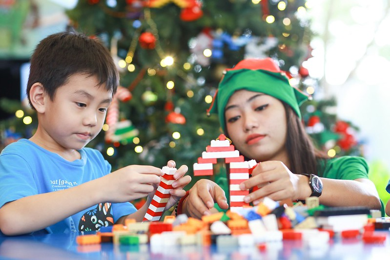 Legoland Malaysia Elves Assisting Children On Their Lego Building Activities