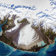 The ice of a piedmont glacier spills from a steep valley onto a relatively flat plain. Malaspina Glacier, Alaska. Original from NASA. Digitally enhanced by rawpixel.