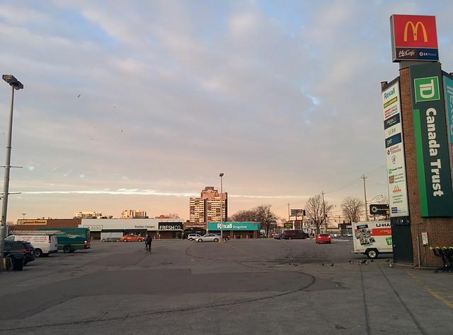 Biking to the west, Galleria parking lot #toronto #wallaceemerson #galleriamall #parkinglot #morning #sky