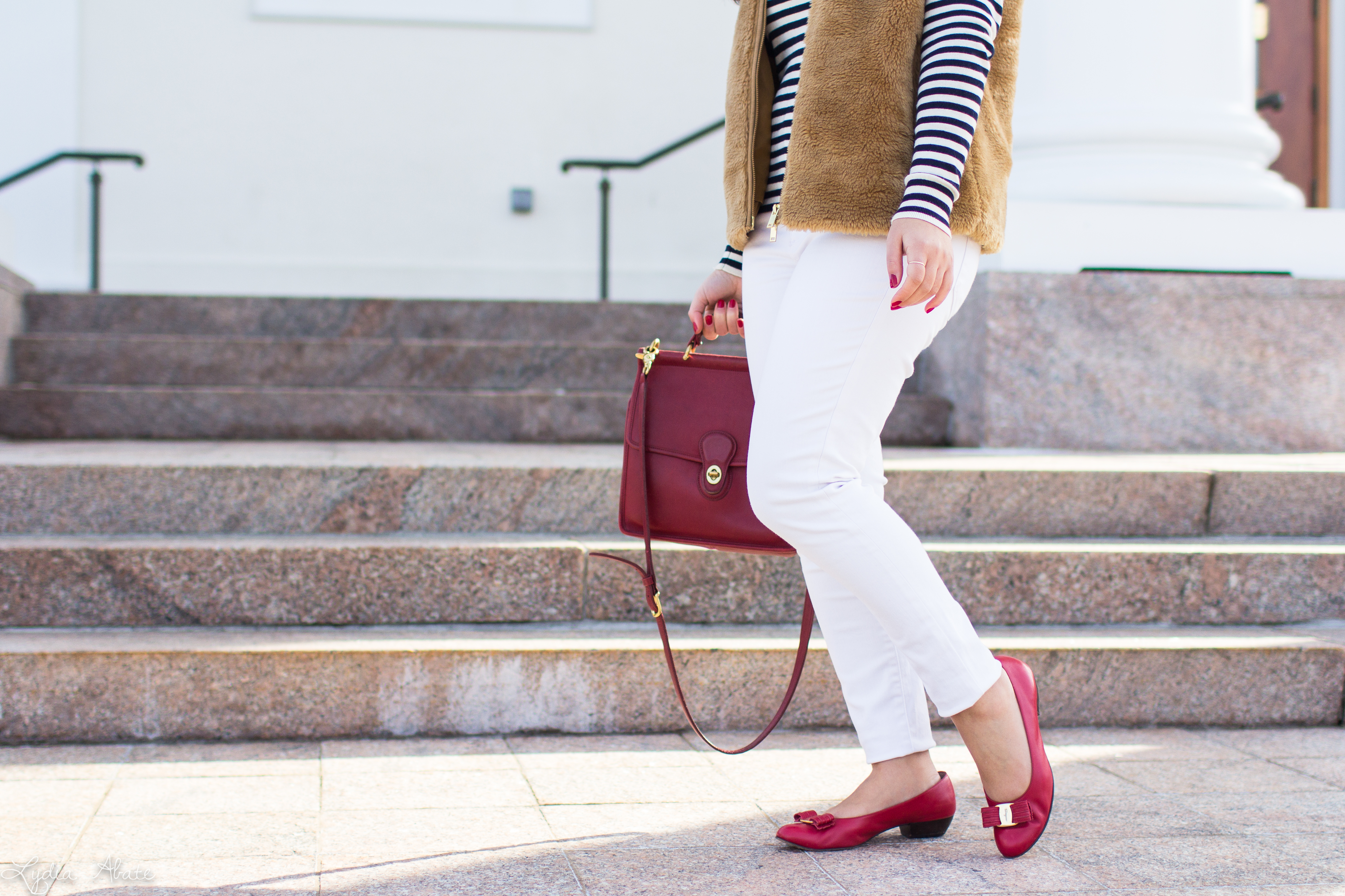 J.Crew plush excursion vest, striped shirt, white jeans, red Ferragamo bow pumps, coach bag-7.jpg