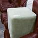 Light green fabric footstool