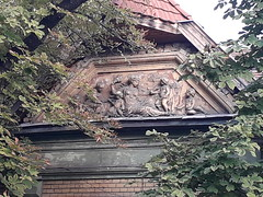 Ancient Scene on a Façade of a Tisztviselőtelep Residential