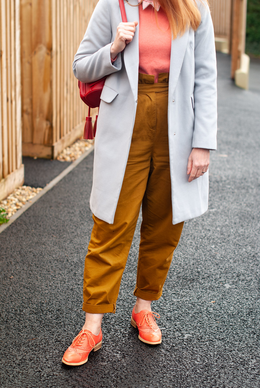 Wearing The Pantone Color of the Year 2019, Living Coral (My Favourite So Far) \ grey duster coat \ tobacco brown peg leg trousers \ coral brogues \ orange Oxfords \ coral cashmere sweater \ red backpack | Not Dressed As Lamb, over 40 style blog