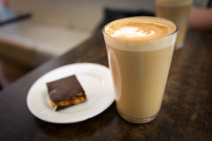 Glass of Coffee Latte with Pastry