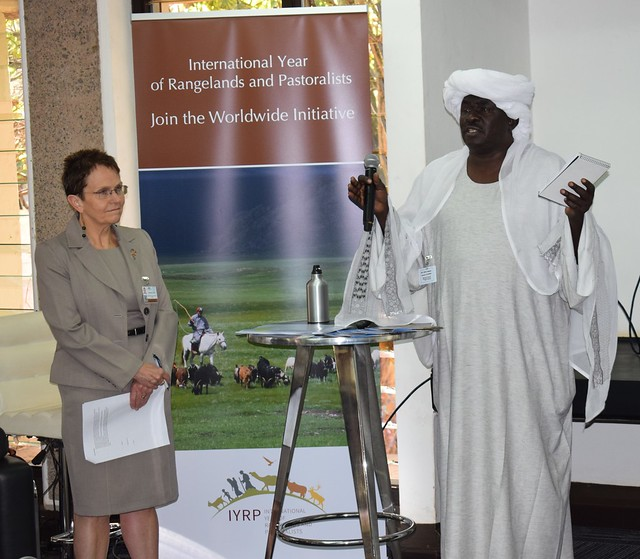 Aboud Gabir Saeed, Sudan state minister and general secretary of the National Council for Environment (left), speaking at the ministerial breakfast