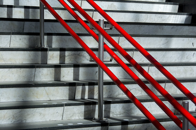 Stairs and red handrails