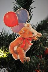 A Bear Bearing Balloons
