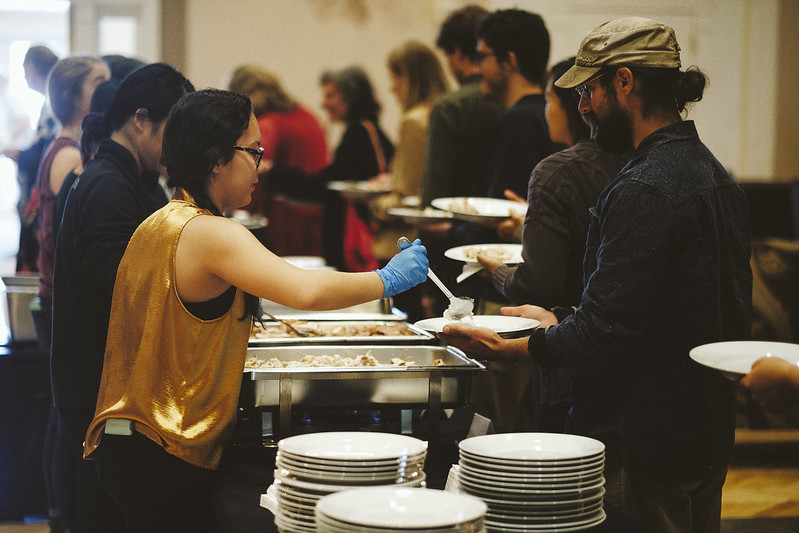 Volunteers at the food symposium served the meal of precolonial foods based on ancestral foodways for 200 guests at the University of Virginia Food Symposium, Our Evolving Food System: From Slavery to Sovereignty.   11/18/2018 Photo credit: Ézé Amos