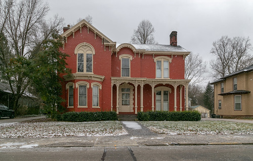house dwelling residence historic paris kentucky unitedstatesofamerica us twostory brick painted gabledell ornate italianate bourboncounty chimney porch scrollwork cornice brackets 11windows segmentalarched hoodmolds bushes hedges sidewalk street trees voussoirs presbyterianmanse 1882