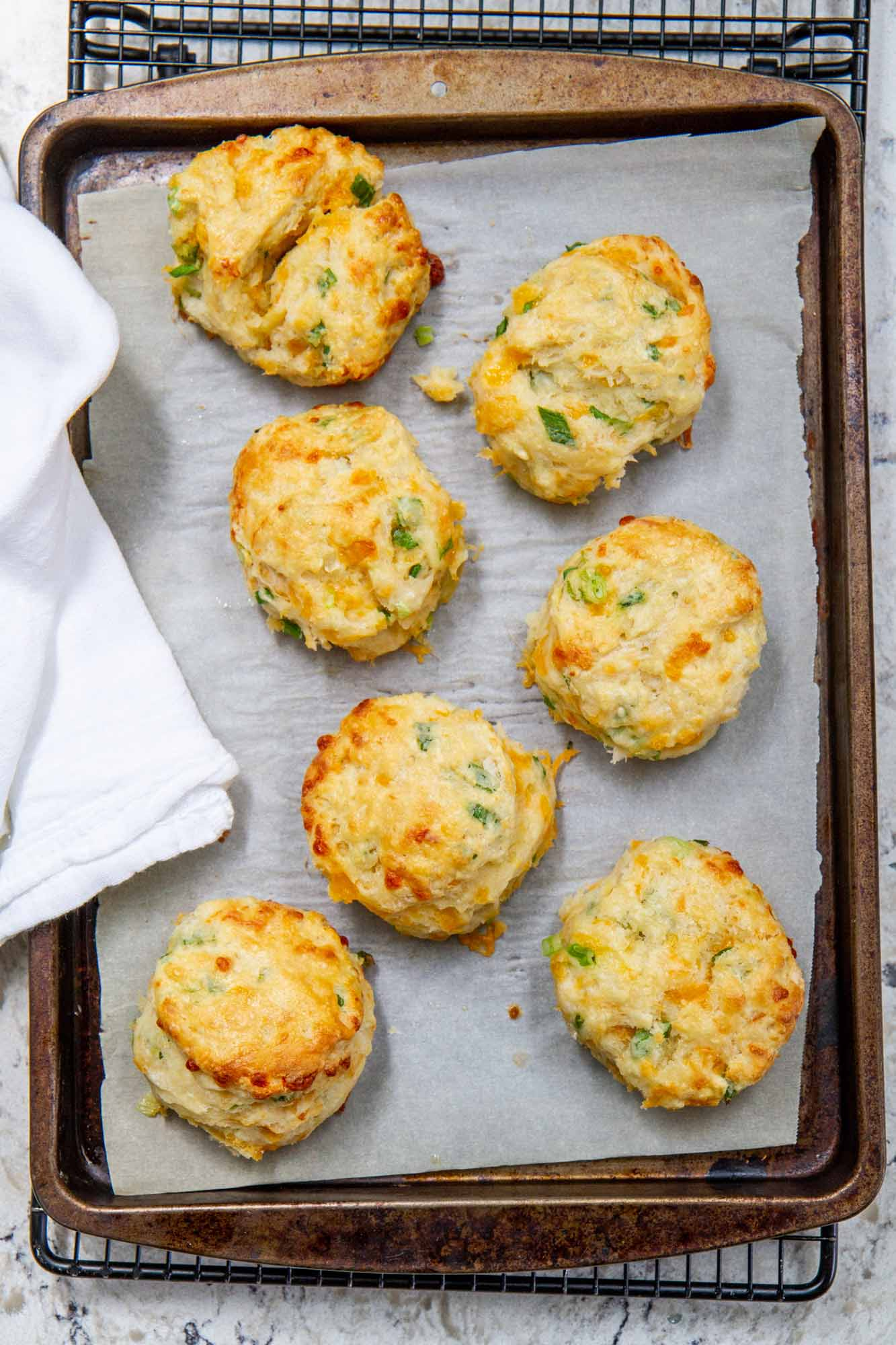Cheddar-Scallion Biscuits -- Easy homemade biscuits filled with layers of melty cheese and sliced scallions. @girlversusdough #girlversusdough #scallions #cheddar #biscuitrecipe
